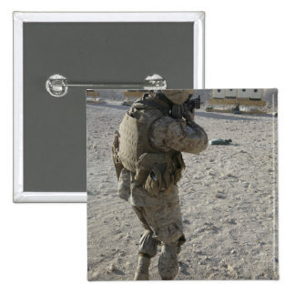 A soldier engages his target on a shooting rang 2 inch square button