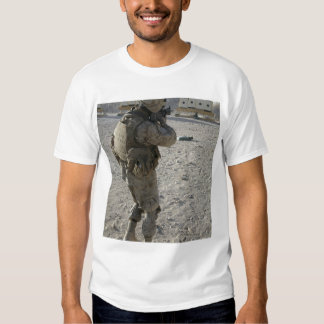 A soldier engages his target on a shooting rang shirt