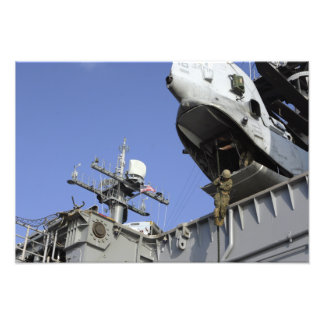 A soldier fast-ropes photo print