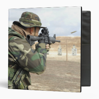 A soldier fires rounds down range 3 ring binder