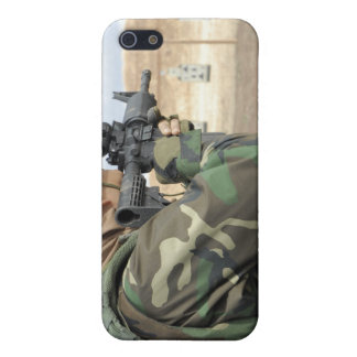 A soldier fires rounds down range iPhone 5 covers
