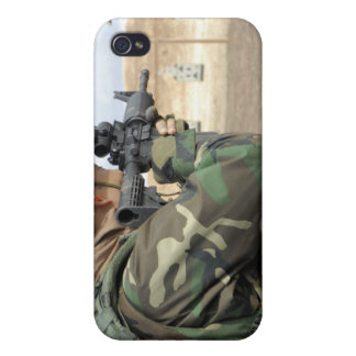 A soldier fires rounds down range cases for iPhone 4