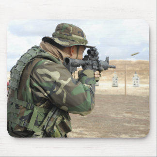 A soldier fires rounds down range mouse pad