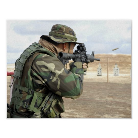 A soldier fires rounds down range poster