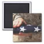 A soldier holds the United States flag 2 Inch Square Magnet