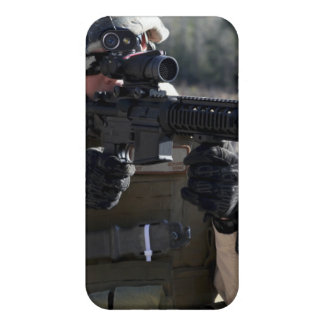 A soldier looks through the scope of a M-4 carb Cover For iPhone 4