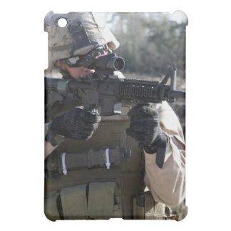 A soldier looks through the scope of a M-4 carb iPad Mini Covers