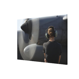 A soldier monitors the performance canvas print