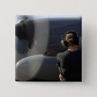 A soldier monitors the performance pinback button
