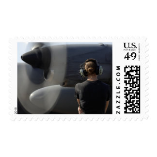 A soldier monitors the performance stamps