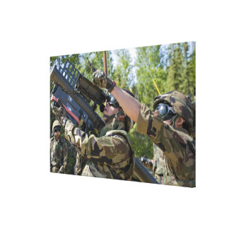 A soldier operates a missile launcher canvas print