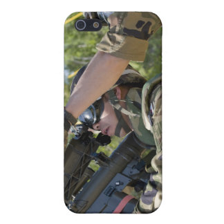 A soldier operates a missile launcher cover for iPhone SE/5/5s