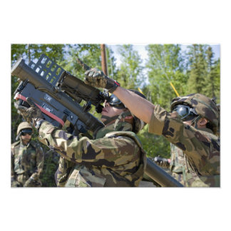 A soldier operates a missile launcher photo print