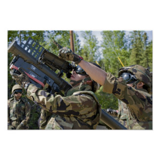 A soldier operates a missile launcher poster