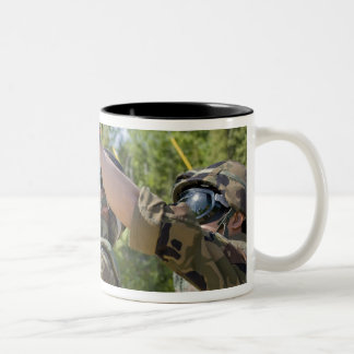 A soldier operates a missile launcher Two-Tone coffee mug