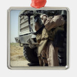 A soldier provides security for Marines Metal Ornament