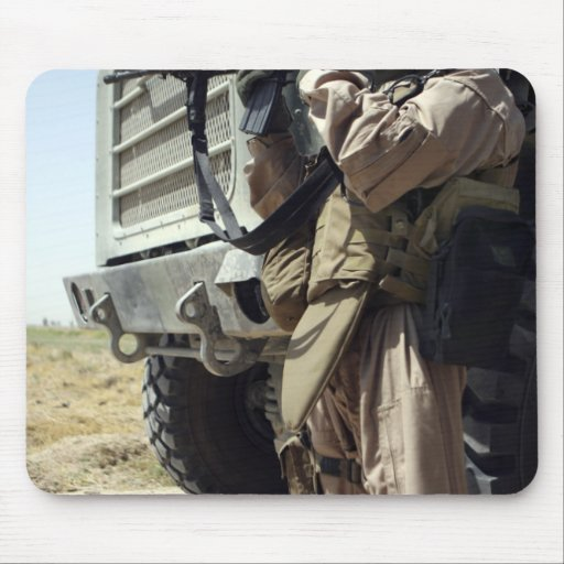A soldier provides security for Marines Mouse Pad