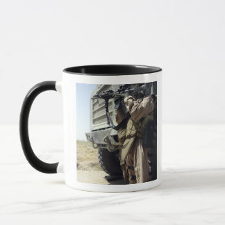 A soldier provides security for Marines Mug