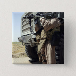 A soldier provides security for Marines Pinback Button