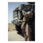A soldier provides security for Marines Poster