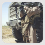 A soldier provides security for Marines Square Sticker