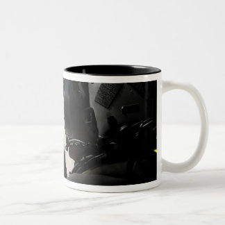 A soldier provides security mug