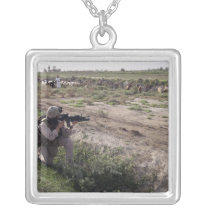 A soldier scans the distance silver plated necklace