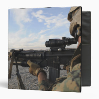 A soldier sights in to fire on a target 3 ring binder