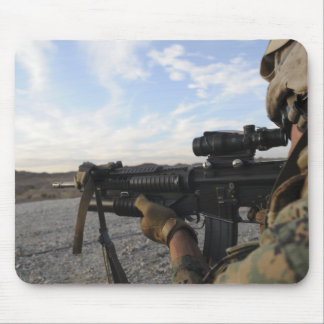 A soldier sights in to fire on a target mouse pad