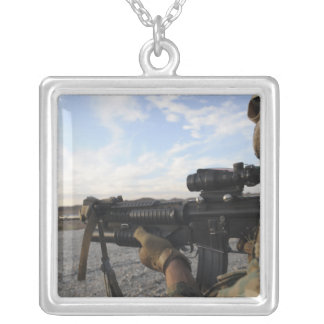 A soldier sights in to fire on a target custom jewelry