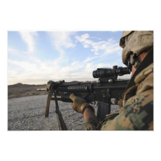 A soldier sights in to fire on a target photo