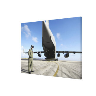 A soldier waits for his C-17 Globemaster III Canvas Print