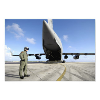 A soldier waits for his C-17 Globemaster III Photo Print