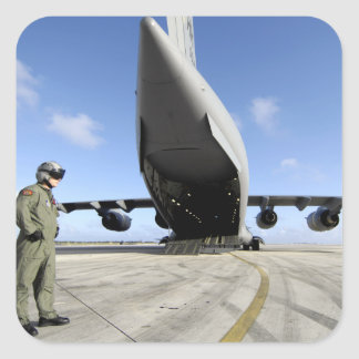 A soldier waits for his C-17 Globemaster III Square Sticker