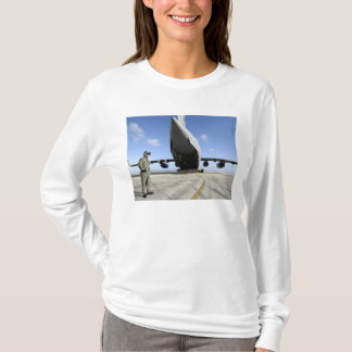 A soldier waits for his C-17 Globemaster III T-Shirt