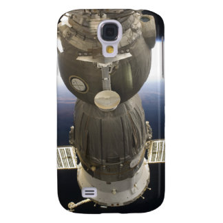 A Soyuz spacecraft backdropped by Earth Galaxy S4 Case
