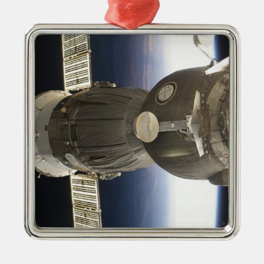 A Soyuz spacecraft backdropped by Earth Metal Ornament