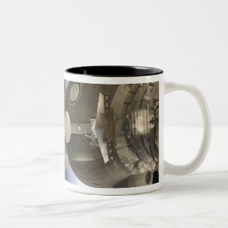 A Soyuz spacecraft backdropped by Earth Two-Tone Coffee Mug