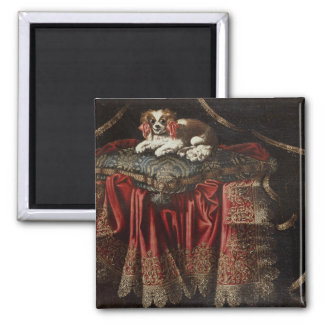 A spaniel seated on an embroidered cushion 2 inch square magnet