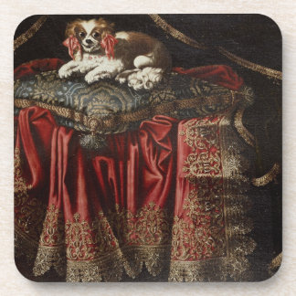 A spaniel seated on an embroidered cushion beverage coaster