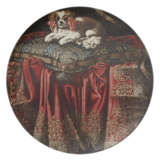 A spaniel seated on an embroidered cushion dinner plate