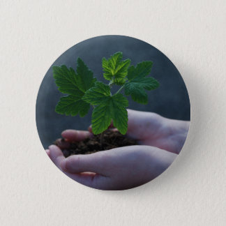 A sprout on a hand pinback button