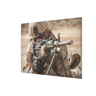 A squad automatic weapon gunner provides securi canvas print