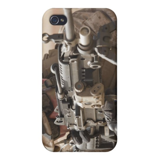 A squad automatic weapon gunner provides securi cases for iPhone 4