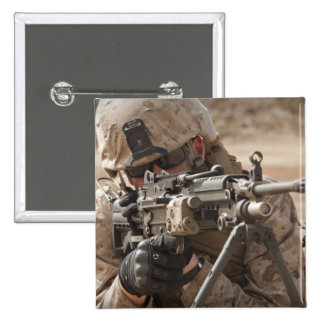 A squad automatic weapon gunner provides securi pinback button