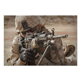 A squad automatic weapon gunner provides securi poster