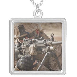 A squad automatic weapon gunner provides securi square pendant necklace