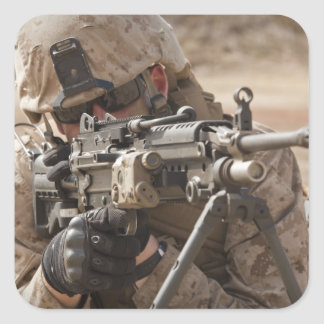 A squad automatic weapon gunner provides securi square sticker