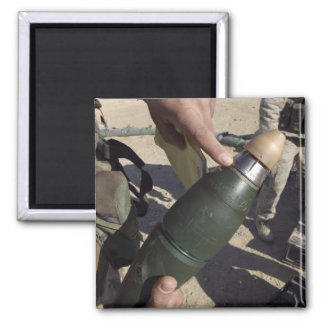 A squad leader points to a delay setting 2 inch square magnet