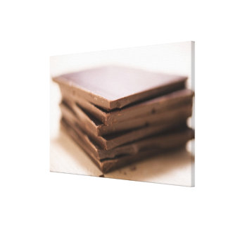 A stack of baker's chocolate ready to be chopped canvas print